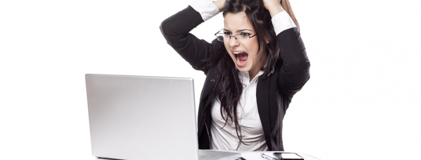 Woman at a computer pulling her hair out